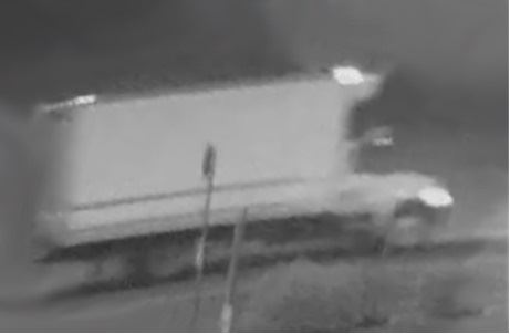 Still image of a truck from security video