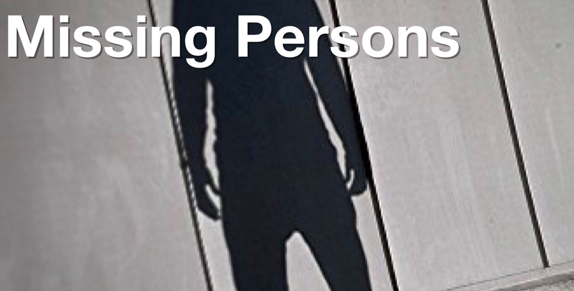 "Text reads ""Missing Person"" over an image of a person's silhouette on a wall"