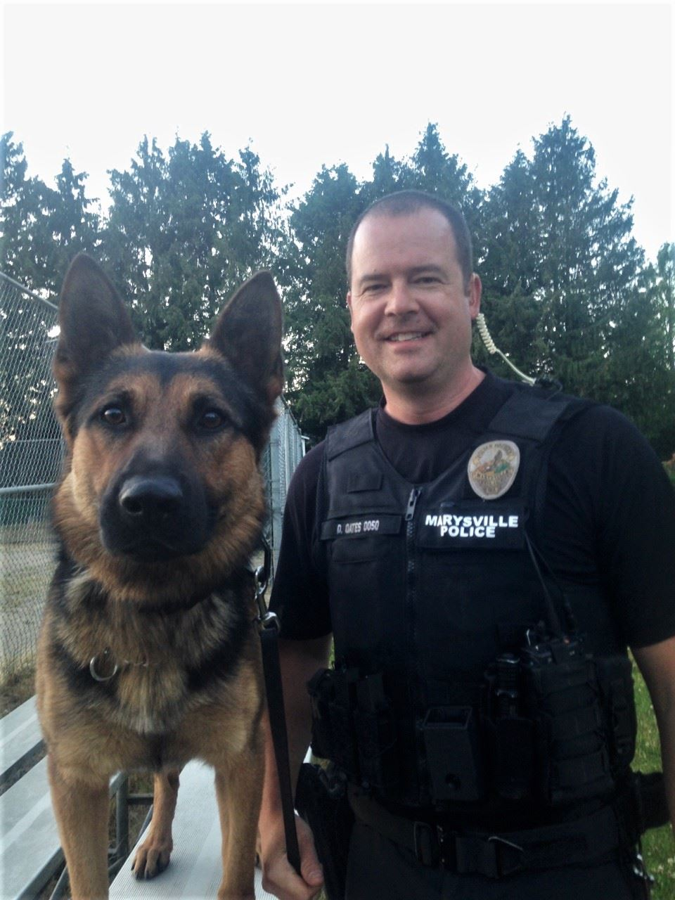 K9 Copper and Officer Oates standing outside